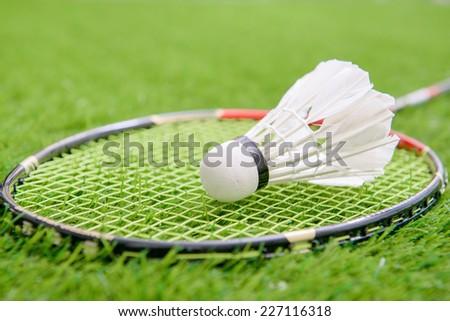 Shuttlecock and badminton racket - stock photo