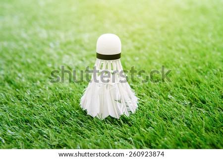 Shuttlecock for badminton on grass - stock photo