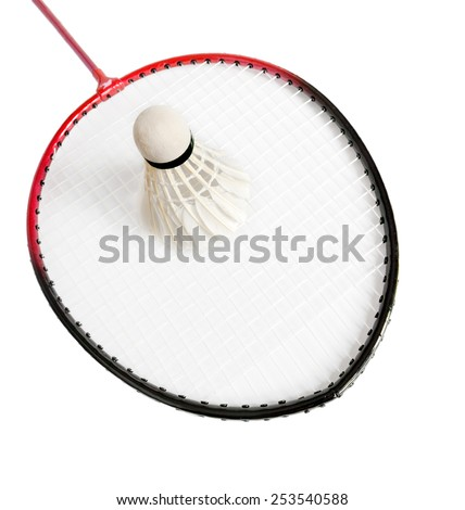 shuttlecock lies on the racket of badminton - stock photo