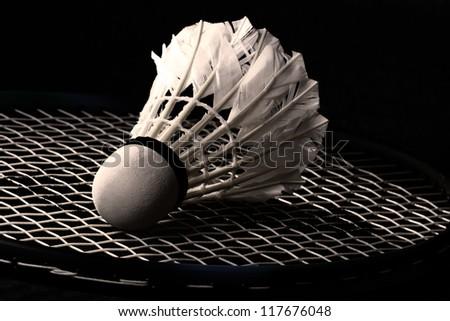 Shuttlecock on badminton racket - stock photo