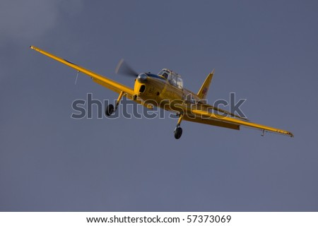 SHUTTLEWORTH, BEDFORDSHIRE - JULY 17: De Havilland Canada DHC-1 Chipmunk RCAF 671 in flight at the Evening Air Display on JULY 17, 2010 at Shuttleworth, Old Warden Park, Bedfordshire, UK.