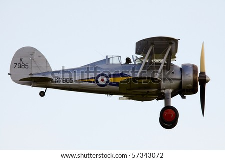 SHUTTLEWORTH, BEDFORDSHIRE - JULY 17: Gloster Gladiator Mk1 K7985 in flight at the Evening Air Display on JULY 17, 2010 at Shuttleworth, Old Warden Park, Bedfordshire, UK.