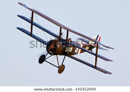 SHUTTLEWORTH, BEDFORDSHIRE, UK - JULY 6: Sopwith Triplane N6290 flying on July 6, 2013 at the Shuttleworth Evening Air Display in Shuttleworth, Bedfordshire, UK.
