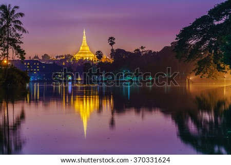 Shwedagon Pagoda at twilight - stock photo