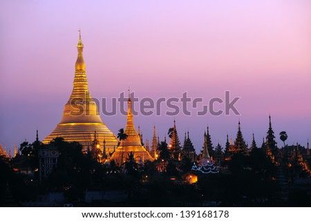 Shwedagon Pagoda in Yangon City, Burma with Beautiful Evening Light: the beautiful golden pagoda, the oldest historical pagoda in Burma and the world, in the evening with great evening light. - stock photo