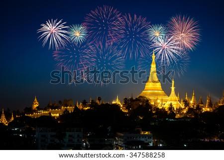 Shwedagon pagoda with fireworks by night, Yangon Myanmar - stock photo