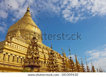 Shwezigon Pagoda(Paya) with flying doves in Bagan(Pagan), Myanmar(Burma) - stock photo