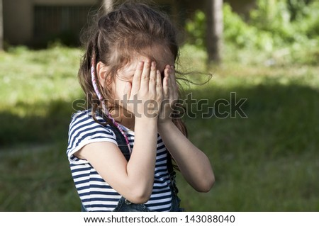 Shy girl covering her face - stock photo