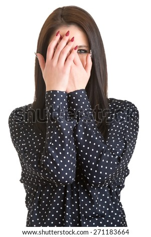 Shy girl covering up her face with her hands, isolated - stock photo