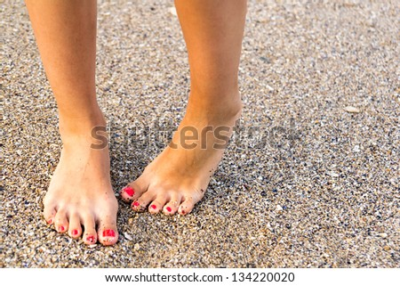 Shy Girl Feet Standing In Sand - stock photo