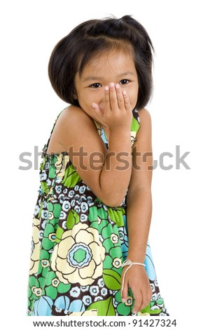 shy little asian girl smiling over white - stock photo