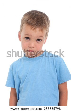 shy little boy on a white background