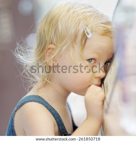 Shy little girl portrait in a cafe - stock photo