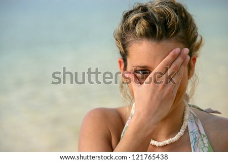 Shy woman at the seaside