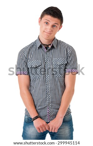 Shy young man looking at camera with embarrassment isolated on white background