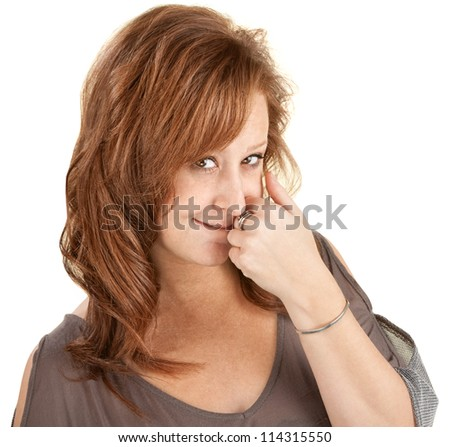 Shy young woman with hand near mouth over white background - stock photo
