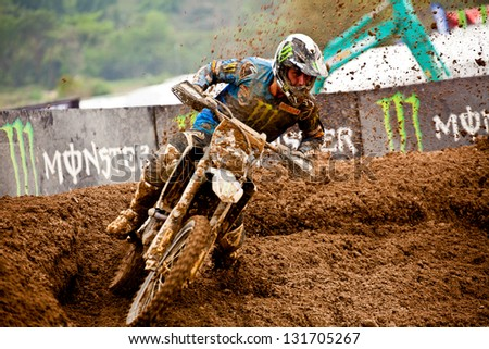 SI RACHA, THAILAND - MAR. 10 : ChristopheCharlier (23) rider of Monster Energy Yamaha during MX2 race of The FIM Motocross World Championship Grandprix of Thailand, on March 10, 2013. Thailand.