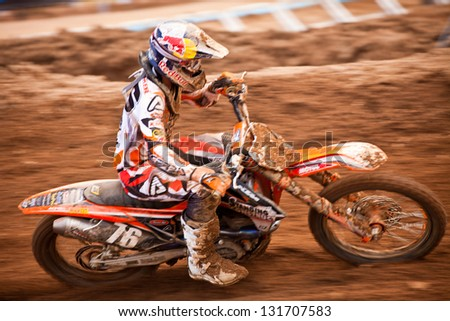 SI RACHA, THAILAND - MAR. 10 : Pascal Ruchenecker (76) rider of Standing Construct KTM during MX2 race of The FIM Motocross World Championship Grandprix of Thailand, on March 10, 2013. Thailand.