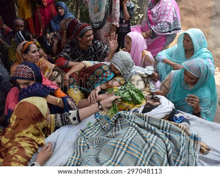 SIALKOT, PAKISTAN - JUL 16: People reacting mourn on martyrdom of their beloved one  during Indian Forces shelling on Chaprar Sector inside Pakistani limits, on July 16, 2015 in Sialkot.
