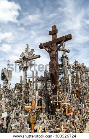 SIAULIAI, LITHUANIA - MAY 1, 2015 : View of hill of crosses with over four hundred thousand crosses and crucifix, which is thought  tradition of putting a cross traces to 1800s. - stock photo