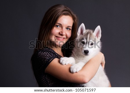 siberian husky puppy with owner