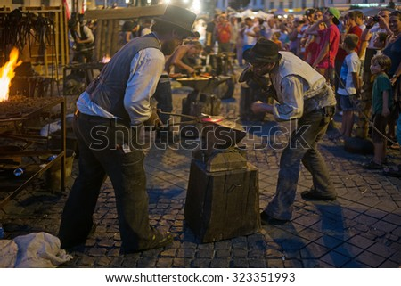 SIBIU, ROMANIA - AUGUST 30: Blacksmith at work on medieval festival on August 30, 2015 in Sibiu, Romania. This festival are very popular in old town of Sibiu.