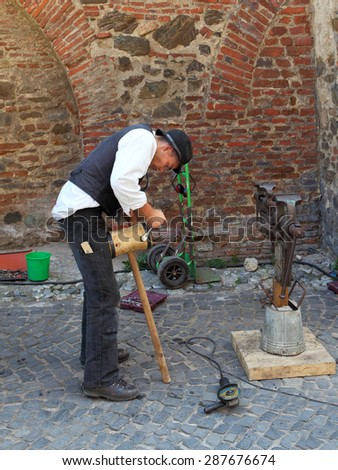 SIBIU, ROMANIA - AUGUST 08, 2012:Unidentified street actor in medieval clothes, working in the street