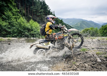 SIBIU, ROMANIA - JULY  16:  A competitor in Red Bull ROMANIACS Hard Enduro Rally with a KTM motorcycle. The hardest enduro rally in the world. July 12-16, 2016 in Sibiu, Romania.