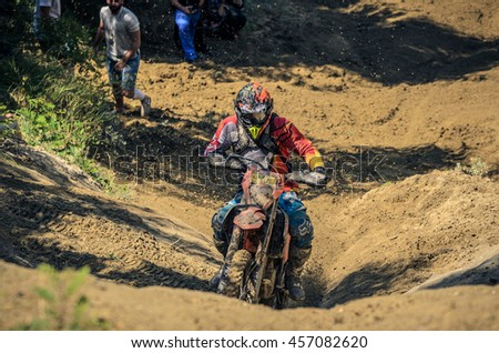 SIBIU, ROMANIA - JULY 16th : A competitor in Red Bull ROMANIACS Hard Enduro Rally with a KTM motorcycle. The hardest enduro rally in the world. July 12-16, 2016