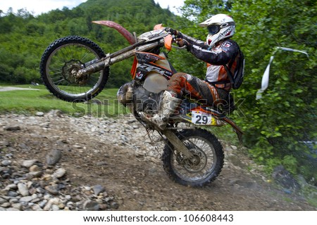 SIBIU, ROMANIA - JUNE 14: Erwin Kovacs competing in Red Bull ROMANIACS Hard Enduro Rally with a KTM EXC motorcycle. The hardest enduro rally in the world. June 14, 2012 in Sibiu, Romania.