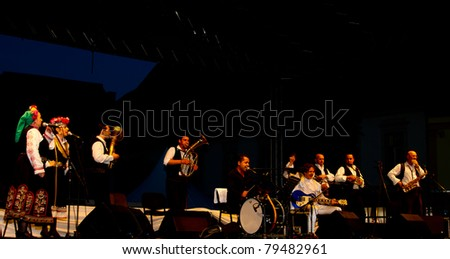 SIBIU, ROMANIA - JUNE 16: Goran Bregovic and His Wedding And Funeral Orchestra performs on stage at International Movie Festival on June 16, 2011 in Sibiu, Romania