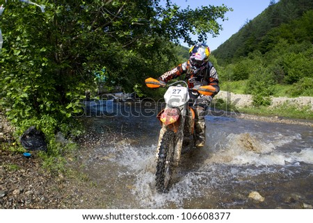 SIBIU, ROMANIA - JUNE 14: Kendall Norman competing in Red Bull ROMANIACS Hard Enduro Rally with a KTM EXC motorcycle. The hardest enduro rally in the world. June 14, 2012 in Sibiu, Romania.