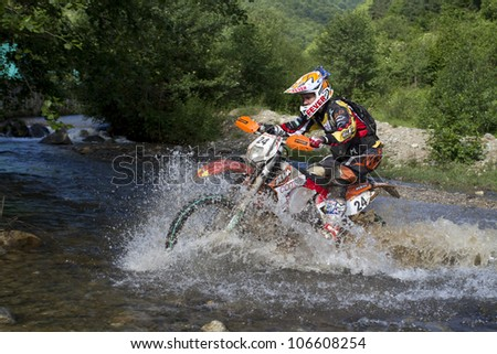 SIBIU, ROMANIA - JUNE 14: Scott Bouverie competing in Red Bull ROMANIACS Hard Enduro Rally with a KTM EXC motorcycle. The hardest enduro rally in the world. June 14, 2012 in Sibiu, Romania.
