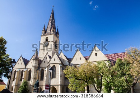 SIBIU - SEPTEMBER 09: Evangelical Cathedral in the center of Sibiu, city designated the European Capital of Culture for the year 2007. Sibiu, Romania on 09 September 2015 - stock photo
