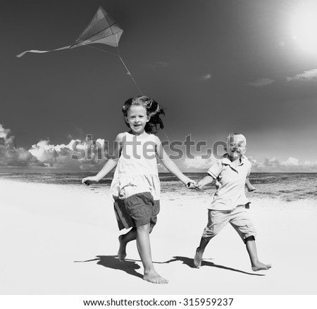 Sibling playing together on the beach Concept