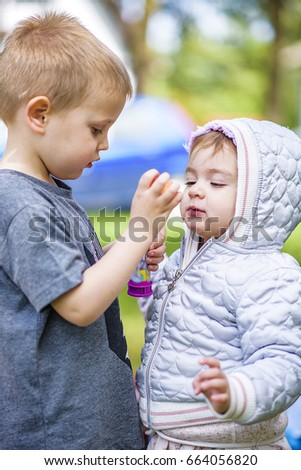 Sister Blowing Her Brother