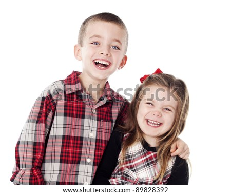 siblings embracing in holiday clothes in studio isolated on white - stock photo