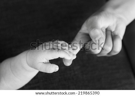 siblings holding hands - stock photo