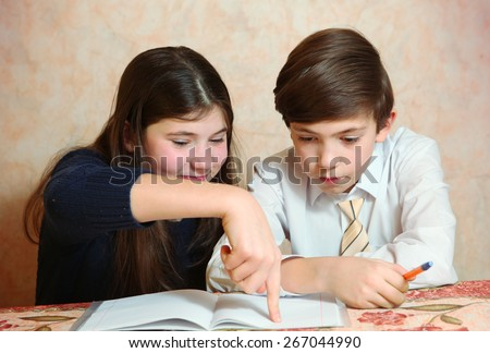 siblings sister help her brother to do his difficult homework - stock photo