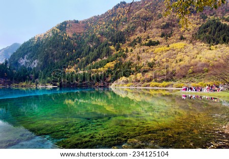 Sichuan,China - October 28, 2013: tourists are walking and exploring around Jiuzhaigou National Park in Sichuan,China.
