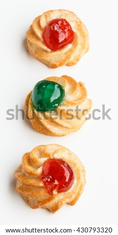 Sicilian almond pastries with candied cherries - stock photo