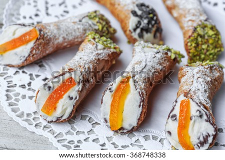 Sicilian cannoli on cake stand - stock photo