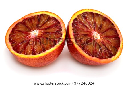 Sicilian orange cut in half in two, isolated on white background