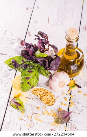 Sicilian pesto ingredients on wooden table, selective focus - stock photo