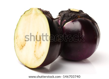 Sicilian spherical shaped purple Organic Eggplant over white background.