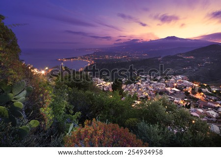 Sicily: Aerial view of Etna Mount and Taormina at sunset - stock photo
