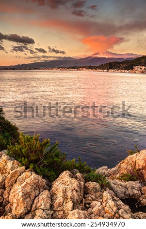 Sicily: Etna seen from Taormina at sunrise - stock photo