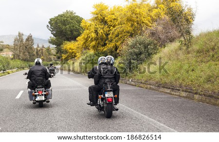 SICILY, ITALY - APRIL 6, 2014 - H.O.G. Malta Chapter on their Harley-Davidson motorcycles on tour in Sicily. Harley Owners Group (H.O.G.) is made up of various local chapters from around the world. - stock photo