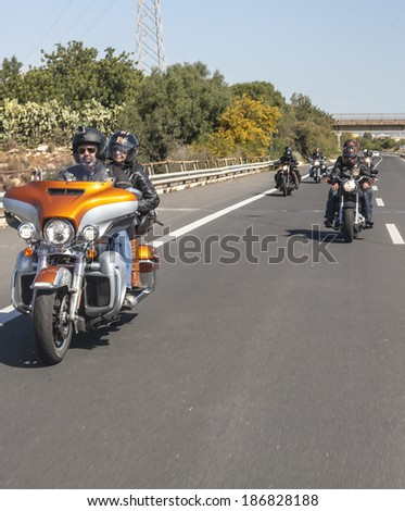 SICILY, ITALY - APRIL 7, 2014 - H.O.G. Malta Chapter on their Harley-Davidson motorcycles on tour in Sicily. Harley Owners Group (H.O.G.) is made up of various local chapters from around the world. - stock photo