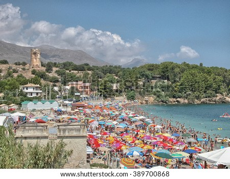 SICILY, ITALY - AUG 10: Tourists enjoy beach life, August 10, 2007 in Sicily, Italy. The region attracts five million tourists every year.